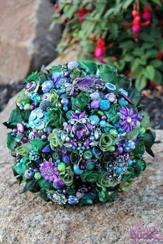 #wedding #bouquet #bride #peacock #silk #flowers #green #purple #blue #teal #brooch #beads #crystal #alternative  www.nicsbuttonbuds.com.au  www.facebook.com/nicsbuttonbuds www.pinterest.com/nicsbuttonbuds www.instagram.com/nicsbuttonbuds  www.twitter.com