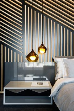 Strips of timber have been laid out in linear form on the wall giving this bedroom a luxuriously opulent and modern feel. De Waterkant Apartment by AA Interiors and OKHA Interiors - incredible wall treatment! Interior Walls, Home Interior, Interior Architecture, Modern Interior, Apartment Interior, Luxury Interior, Interior Ideas, Contemporary Apartment, Contemporary Bedroom