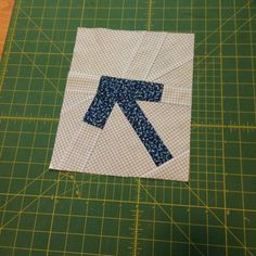 A group within the Ann Arbor Modern Quilt Guild is working together on a charity quilt featuring improvisational arrow blocks.  Today I grabbed some scrap fabric and experimented with a piecing str...
