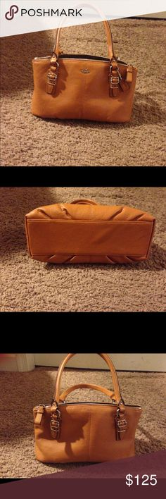 Coach handbag Brown leather coach handbag. Used only twice. It's in perfect condition--no signs of wear, no smells, no scratches and no marks. Dimensions of Handbag is 10.5 inches x 4 inches x 6 inches. It has one interior pouch. Coach Bags Satchels