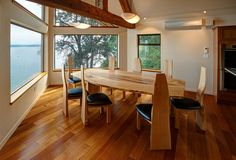 Silver Bullet dining table in boat shaped maple slabs