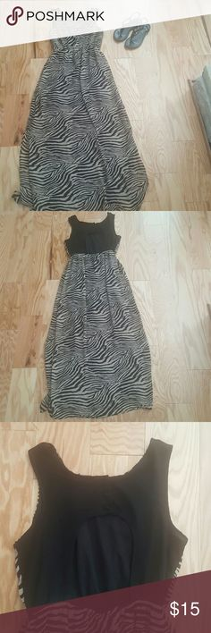Forever 21 Zebra Print Maxi Dress Captivate and conquer in this daring maxi dress. Features keyhole back with three button closure, elastic waist,side slits, and lined inside. Approximately 38 inches from the waist. Made in China  Reasonable offers welcome No trades Forever 21 Dresses Maxi