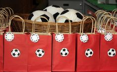 The favors were plush IKEA soccer balls for the little kids and a red paper bag with a water bottle, stickers, mini soccer balls and tattoos for the bigger kids. Each bag had a tag on it that said 'Good Game!' Birthday I Soccer Party Favors, Soccer Birthday Parties, Birthday Favors, Boy Birthday, Birthday Ideas, Barcelona Party, Team Dinner, Football Themes, Kids Party Themes