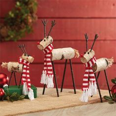 3 sizes.Handcrafted from solid birch logs, graduated size reindeer feature antique finish metal legs and antlers, jute tails, and knit scarves with tassel fringe.