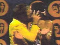 Sonny and Cher comedy hour Sonny kissing Cher on front stage of the show!