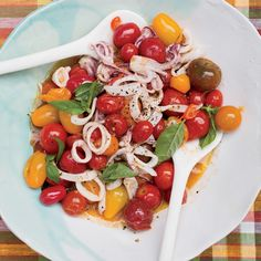 Top Chef judge Tom Colicchio slow-cooks juicy cherry tomatoes and garlic until they become a sauce for tender squid.