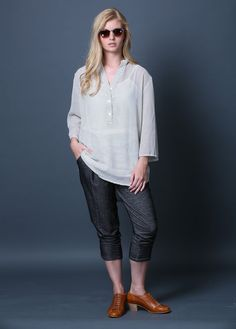 The Yaara shirt features a chinese collar, 3 buttons down the front, and a gentle pleat at the back. The back of this shirt is longer than the front, for a classy, flattering, and comfortable look. This great shirt is available in a variety of materials