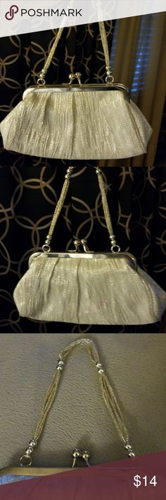 🌹Beautiful Clutch Purse for a Night Out!🌹 Gorgeous silver clutch purse silver with a silver small handle. Just beautiful! A small stain from lipstick picture 7. Not noticeable unless you're close up and taking photos. Priced to sell! La Regale Bags Clutches & Wristlets