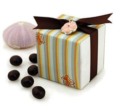 """Butterfly Print Favor Box w/ Optional Flower Charm Box Size: 2""""Wx 2""""L x 2""""H Jump into spring with our Butterfly Print Favor Box! This adorable favor box is decorated with a striped print paper adorned with butterflies. Fill the inside with your choice of sweet confections to appeal to your guests' discriminating tastes. The cute and chic Butterfly Print Favor Box can be personalized with an optional charm or tag. These gorgeous Butterfly Print Favor Boxes are the perfect addition to any…"""