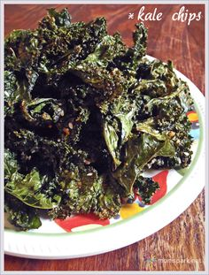 """Crispy """"Everything"""" Kale Chips Recipe.  Made these today after getting a giant bundle of kale at the farmer's market.  This is the best recipe yet due to all the spice suggestions.  Notes:  upped temp to 350. Roasted each batch for about 12-15 minutes on bottom rack to make extra crispy.  Used every seasoning except poppy seeds and parm.  The kids ate 2 batches in one sitting.  ;D"""