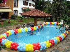 Great decorative pool edging idea!  Buy balloons in bulk at http://emardigrasbeads.com
