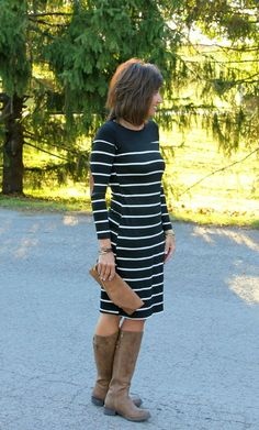 Striped dress with brown boots for fall.