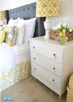 Dark headboard and white night tables