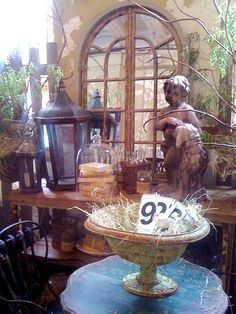 Can't have too many urns, lanterns and arched window frames...not to mention metal garden chairs, glass domes ..etc  The Seed Box Antiques: June 2012