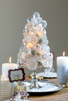 To make this knob-bedecked tree, hot glue an assortment of clear and mercury glass knobs to a StyrofoamTM cone. Then simply tuck crystal-like beads topped with filigree bead caps into any gaps to fill in this stunning centerpiece. Christmas Crafts For Gifts, All Things Christmas, White Christmas, Christmas Holidays, Christmas Decorations, Holiday Decor, Christmas Ideas, Door Knobs Crafts, Hobby Lobby