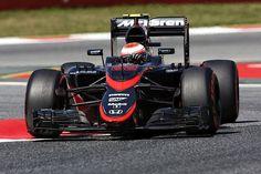 Jenson Button sports McLaren's new livery
