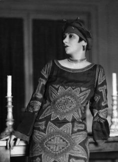 1923. Model wearing paisley patterned dress