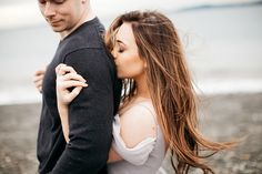 Romantic and intimate engagement shoot on the shores of Puget Sound in Seattle by Catie Coyle