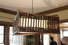 Light fixture used twig garden fencing for an unusual chandelier...