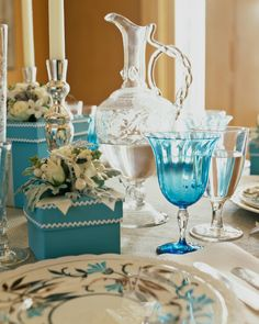 Eddie's mix of old and new includes a set of lusterware plates found at the Elephant's Trunk on a previous excursion, vintage Steuben, a Venetian glass pitcher found at Brimfield and a charming DIY box vase.