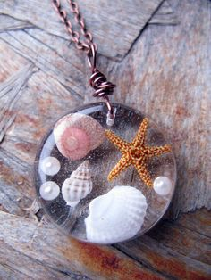 Beach Necklace - Real shells and starfish in Resin - Nautical Pendant - Ocean Life Necklace - Beach Pendant - Wire Wrapped Pendant. $12.00, via Etsy.