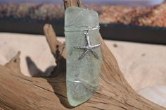 Light aqua sea glass Christmas ornament or sun catcher with a starfish.
