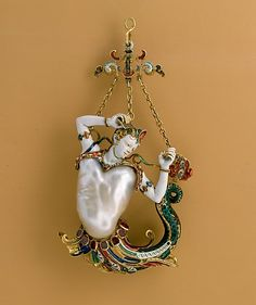 Pendant in the form of a siren Date: probably about 1860 Culture: European Medium: Baroque pearl with enameled gold mounts set with rubies Dimensions: H. 4-3/16 in. (10.6 cm) Classification: Metalwork-Gold Credit Line: The Jack and Belle Linsky Collection, 1982 Accession Number: 1982.60.376 This artwork is currently on display in Gallery 542