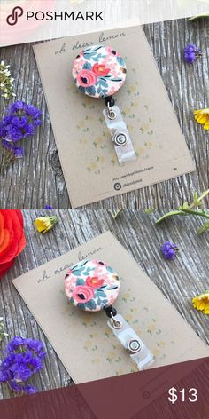 """Rifle Paper Co Floral Badge Reel Rifle Paper Co. fabric badge reel♡ Badge reels are great for nurses, doctors, medical students, teachers and anyone who is required to wear an ID badge at work. A super cute way to spruce up your work attire! Badge reel is handmade with a fabric cover button. Made with Rifle Paper Co fabric in """"Rosa Peach"""" You can wear them on lanyards, shirts, pockets, belt loops and more! Comes with a clear plastic snap back and a swivel clip. Handmade by me & brand new…"""