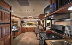 Gorgeous hybrid travel trailer with 3 pop-outs and a slide.  I'd love to take my family cross-country in this RV.  Oh, the places we'd go!
