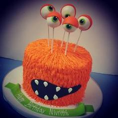 This cute monster Halloween cake cake features goo-ga-lie eyes (is that even a word?!) and orange piped hair.. **Custom colors...