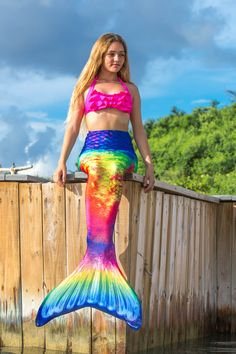 Looking for an adult mermaid tail? Fin Fun's Amazon Rainforest mermaid tail draws inspiration from the bold colors found in nature and melds them together in an exotic design that's bound to create excitement! Gift ideas for mermaids can be tricky, but not when you know where to go! Our premium-quality fabric tails make the perfect gifts for adults who love to swim, and they're designed to last!