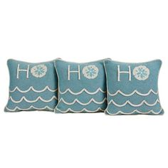 The Sand and Shore Trio Set of 12 x 12 holiday pillows shows off a textured turquoise chambray with shiny creme rope trim in a wave-inspired pattern along the bottom.