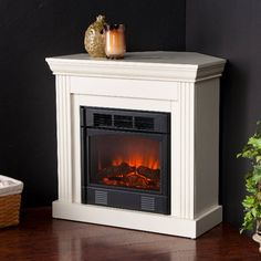 Providing all the style and class of a full-sized fireplace in a conveniently compact size, the Wexford Petite Convertible Ivory Black Electric Fireplace. Fireplace Heater, Fake Fireplace, Fireplace Inserts, Fireplace Design, Fireplace Mantels, Fireplace Ideas, Propane Fireplace, Fireplace Modern, White Fireplace
