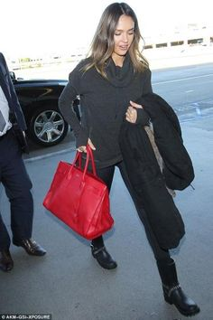 Jessica Alba wearing Saint Laurent Sac Du Jour Bag in Rouge, Dav Seattle Rain Boots and Sweaty Betty Escape Luxe Jumper