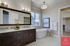 View image galleria of our ensuites and bathrooms. Astoria Custom Homes is committed to ensuring your home is built with craftsmanship and quality. Custom Home Builders, Custom Homes, Bathroom Images, Corner Bathtub, Luxury Homes, Double Sinks, Mirror, Calgary, Bathrooms