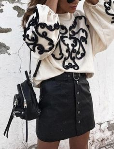 cute outfit. black denim skirt. backpack satchel. embroidered shirt. embroidered top. edgy look. edgy vibes.