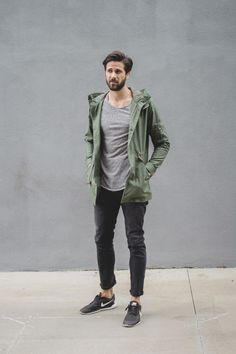 How to wear: olive lightweight parka, grey crew-neck sweater, black jeans, black low top sneakers Sneakers Outfit Men, Sneaker Outfits, Nike Sneakers, Sneakers Style, Brown Sneakers, Casual Sneakers, Dark Jeans Outfit, Black Jeans, Pants Outfit