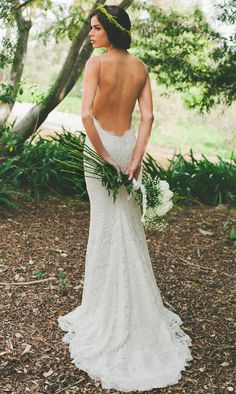 Backless, open back lace wedding dress. Even the bouquet is gorgeous!