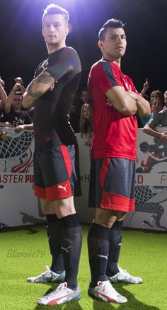 Marco reus and sergio agüero posing for advertisement for new football boots from Puma