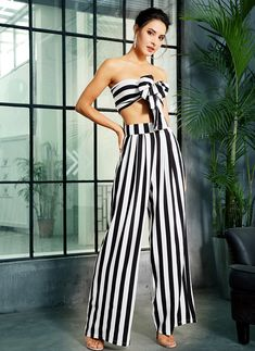 Look ultra chic in this tow piece fancy striped jumpsuit with high waist pants and a tie front crop top. Two Piece Jumpsuit, Jumpsuit Pattern, Casual Jumpsuit, Striped Jumpsuit, Black Jumpsuit, Striped Two Piece, Fancy Tops, Front Tie Top, Smarty Pants