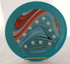 Beautiful 10.5 fused glass bowl inspired by the beauty of the southwest. This bowl can be used for serving, but its also a beautiful piece to add to any home decor. It sits nicely without the stand, but can also be ordered with the stand. Hand-washing is highly recommended. Not intended for oven or microwave use. All fused glass art is crafted by me in my home studio. During each phase of firing the glass is carefully annealed to ensure it is durable as well as beautiful. Keep in mind that…
