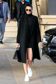How To Accentuate Your Legs À La Kendall Jenner #refinery29 http://www.refinery29.com/kendall-jenner-style#slide-2 All black — well, almost all black — is always a good answer....