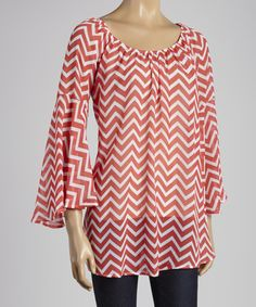 With+romantic+ruching+and+breezy+bell+sleeves,+this+top+is+feminine+perfection.+Its+vibrant+coral+hue+and+attractive+zigzag+motif+will+update+any+ensemble+with+a+fresh+perspective.
