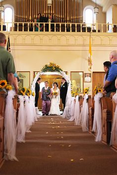 sunflower and tulle church wedding decor with arch