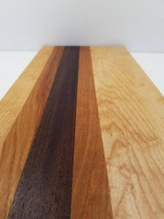 Maple, Walnut, And Cherry Wood Cutting And Serving Board.