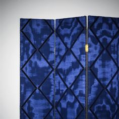 LOSANGE MOIRE by Dedar - Dedar presents a large geometric pattern made with a double screen printing: a print with a lacquered effect first, then a finishing with flock applications. For decorative seating and drapes. Coord. Amoir Libre.