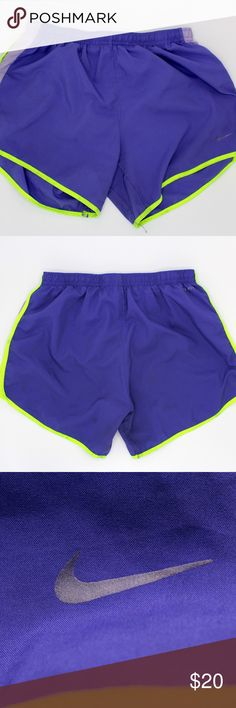Nike Womens Extra Large Shorts Dri-fit with small faint stain on front purple part, yellow part and all along the hem  Measurements: 4.5 inches inseam  Materials: 100% polyester  Shipping: Items ship next day with priority mail Nike Shorts