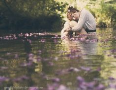 Have subject sit in water, get assistant to throw petals upstream.