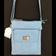 """NWT Cross Body Purse  Very soft faux leather. Beautiful blue. Two top zipper openings. Back zipper pocket and a middle snap closure pocket. Please see the identical beige listing for a pic of middle pocket.  11.5 X 10"""".   Alyssa Bags Crossbody Bags"""