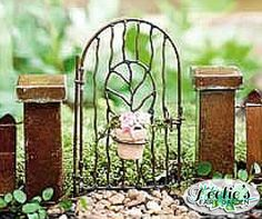 One look at this gorgeous gate and you'll know it leads to a majestic place! Perfect! : www.teelieturner.com  #fairygarden